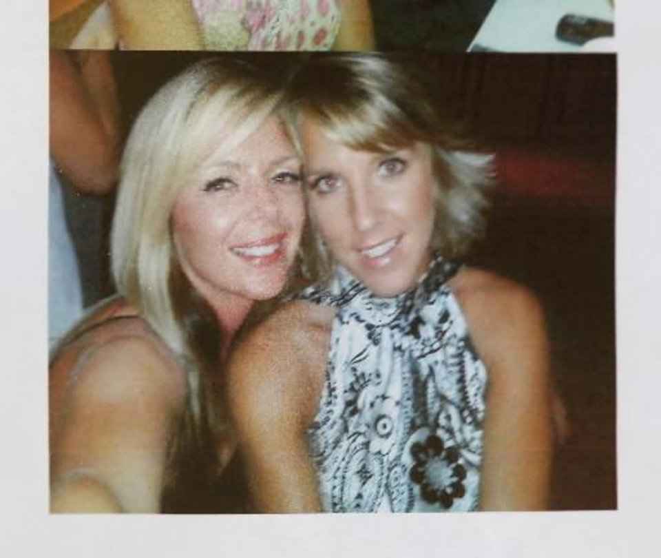 This is one of about six photos of Barbara Diane Day (on the right) pictured with unidentified friends, taped to the front door of the couple's fitness center in  Elgin. Residents of  Elgin Okla, react Tuesday, July 20, 2010, to yesterday's shooting death of local teacher Barbara Diane Dye at the hand of her husband, Raymond Lee Dye, 42, in the parking lot of a bank in this southwest Oklahoma community of about 1400 people just north of Lawton. Photo by Jim Beckel