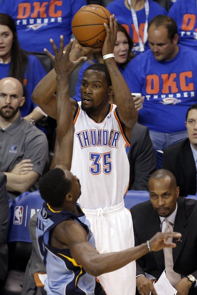 Photo - Oklahoma City's Kevin Durant (35) shoots a 3-pointer as Memphis' Tony Allen (9) defends him during Game 7 in the first round of the NBA playoffs between the Oklahoma City Thunder and the Memphis Grizzlies at Chesapeake Energy Arena in Oklahoma City, Saturday, May 3, 2014. Photo by Sarah Phipps, The Oklahoman
