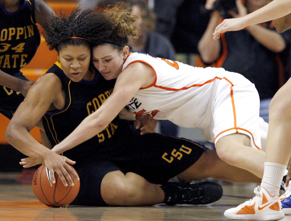 Photo - Oklahoma State's Lindsey Keller (25) and Coppin State's Dawnnae Roberts (32) fight for a loose ball during the women's college game between Oklahoma State University and Coppin State at Gallagher-Iba Arena in Stillwater, Okla.,  Saturday, Nov. 26, 2011.  Photo by Sarah Phipps, The Oklahoman