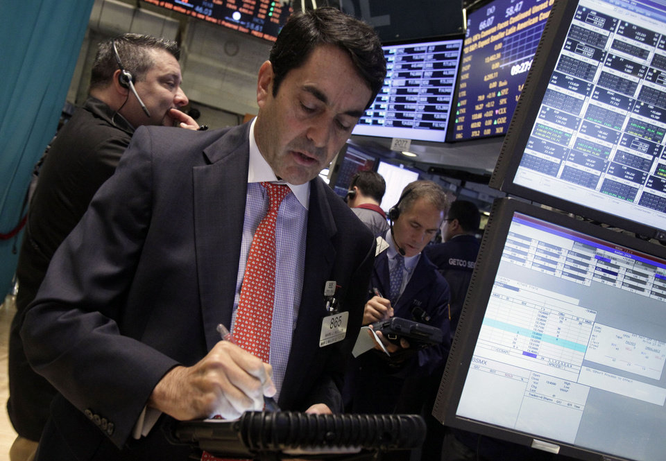 Photo -   Trader Mark Muller, center, works on the floor of the New York Stock Exchange Wednesday, Oct. 3, 2012. Stocks are mostly higher in early trading on Wall Street Wednesday after a measure of private sector hiring came in better than economists were expecting. (AP Photo/Richard Drew)