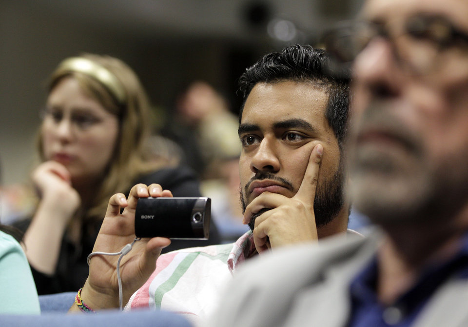 Photo -   A man listens as Mariela Castro, daughter of Cuban President Raul Castro, speaks at an academic conference at San Francisco General Hospital in San Francisco, Wednesday, May 23, 2012. Castro, an outspoken gay rights advocate, spoke at a medical lecture for health care providers on care for transgender patients. (AP Photo/Eric Risberg)