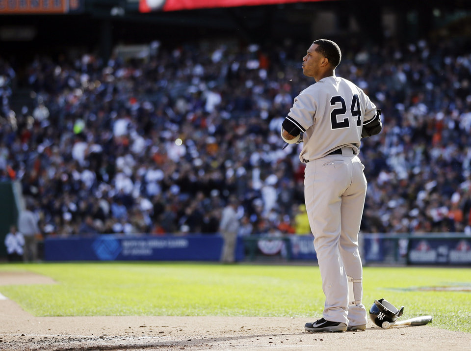 Photo -   New York Yankees' Robinson Cano reacts after striking out in the first inning during Game 4 of the American League championship series against the Detroit Tigers Thursday, Oct. 18, 2012, in Detroit. (AP Photo/Matt Slocum)