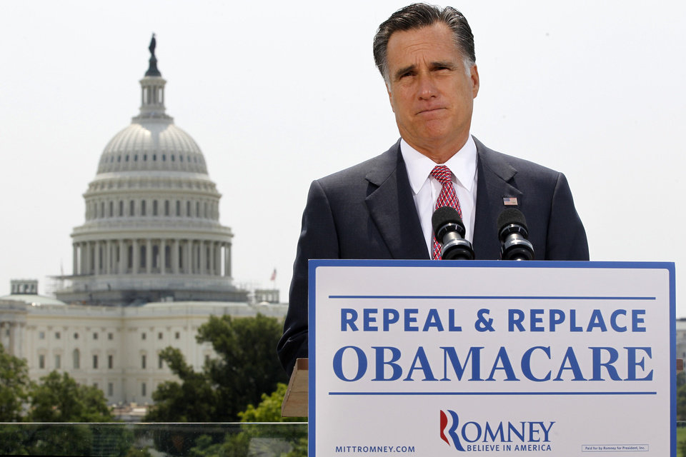 Photo -   With the Capitol in the background, Republican presidential candidate, former Massachusetts Gov. Mitt Romney speaks about the Supreme Court's health care ruling, Thursday, June 28, 2012, in Washington. (AP Photo/Charles Dharapak)