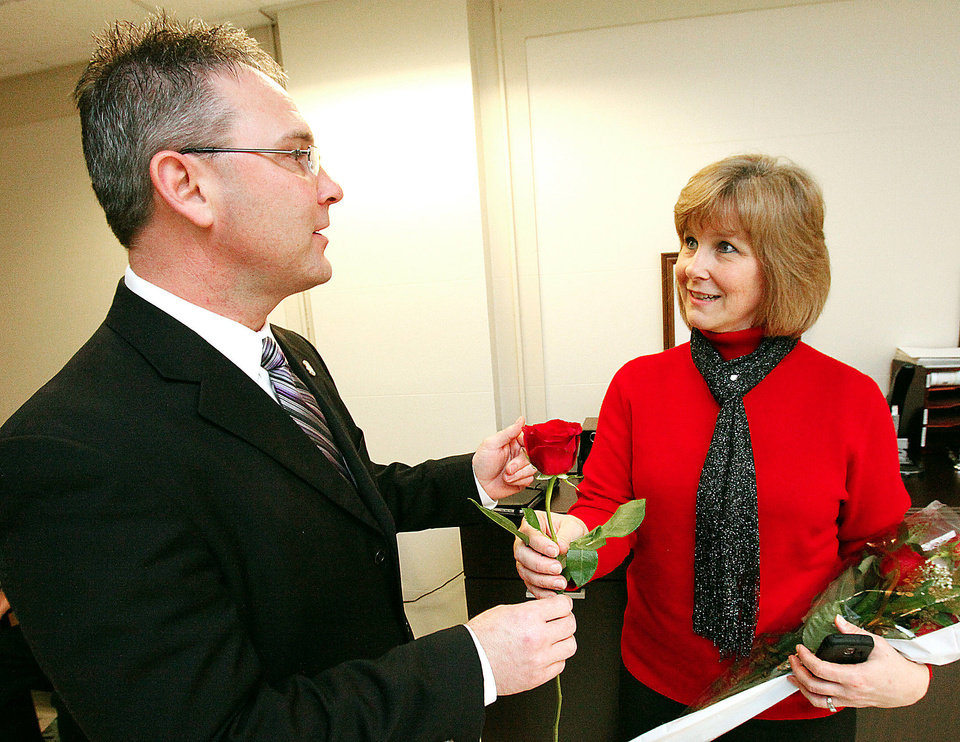 State Rep. Tom Newell, R-Seminole, gets a rose from Gaylene Stupic of Edmond as part of 2012 Rose Day at the state Capitol. Photo by David McDaniel, The Oklahoman  <strong>David McDaniel - The Oklahoman</strong>