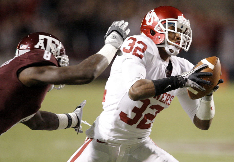 OU's Jamell Fleming intercepts a pass in front of Texas A&M's Jeff Fuller during the college football game between the University of Oklahoma (OU) and Texas A&M University at Kyle Field in College Station, Texas, on Saturday, Nov. 6, 2010.  Photo by Bryan Terry, The Oklahoman