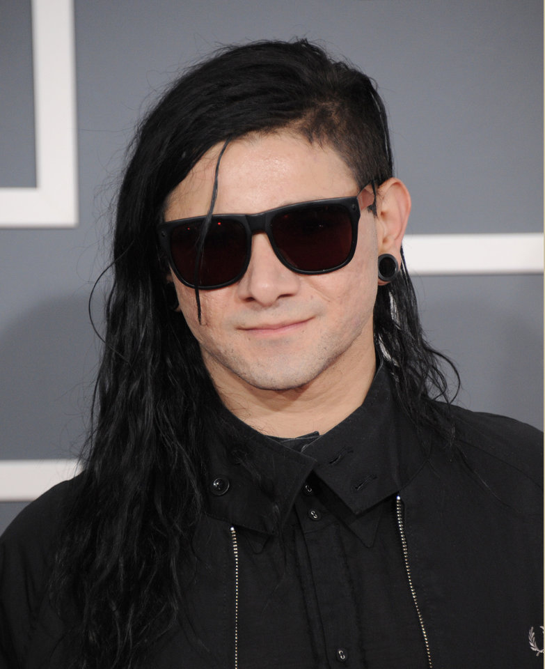 Photo - Skrillex arrives at the 55th annual Grammy Awards on Sunday, Feb. 10, 2013, in Los Angeles.  (Photo by Jordan Strauss/Invision/AP)
