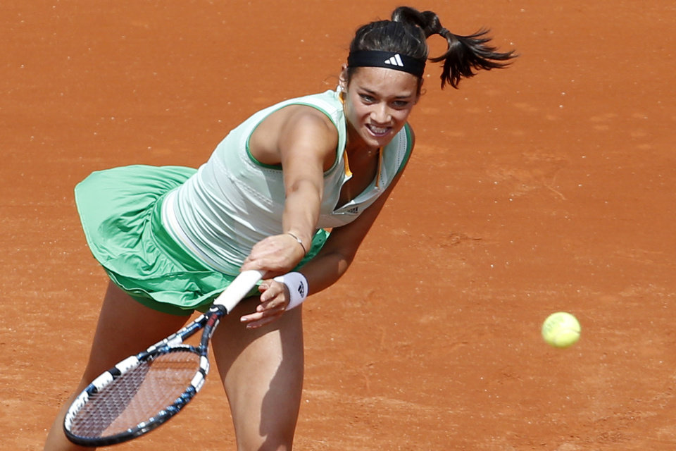 Photo - France's Alize Lim serves the ball during the first round match of the French Open tennis tournament against Serena Williams of the U.S. at the Roland Garros stadium, in Paris, France, Sunday, May 25, 2014. (AP Photo/Darko Vojinovic)