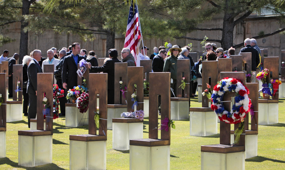 Photo - Family and friends gather at the chairs during the 18th Anniversary Remembrance Ceremony at the Oklahoma City National Memorial and Museum, Friday, April 19, 2013. Photo By David McDaniel/The Oklahoman