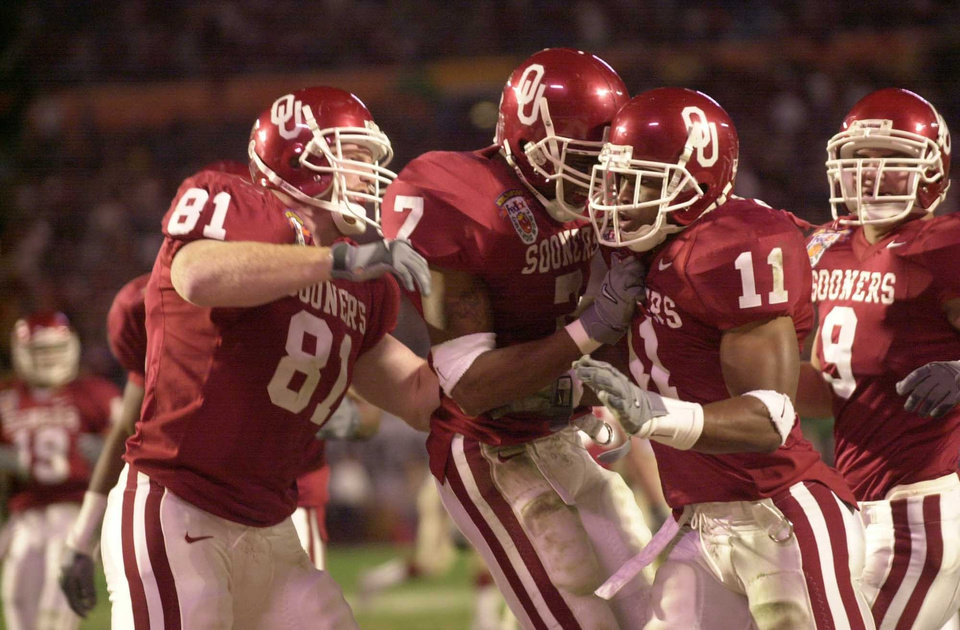 NATIONAL CHAMPIONSHIP, COLLEGE FOOTBALL: OU vs Florida State at the Orange Bowl. Sooners Chris Hammons (81), Brandon Everage (7), Ontei Jones (11) and Roger Steffen celebrate play. Staff photo  by Bryan Terry.