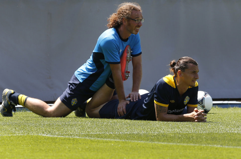 Photo -   Sweden's Zlatan Ibrahimovic receives assistance during a training session at the Euro 2012 soccer championship in Kiev, Ukraine, Wednesday, June 13, 2012. (AP Photo/Sergei Grits)