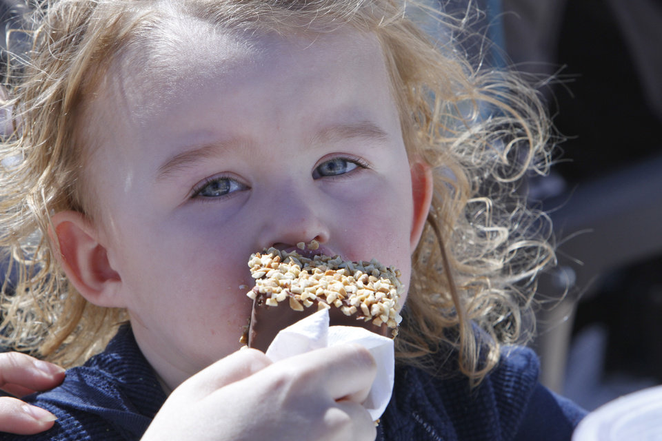 Aubrey Vanhooser, 2, eats a chocolate dipped cheesecake at the Oklahoma State Fair, Tuesday, September 18, 2012. Photo By David McDaniel/The Oklahoman
