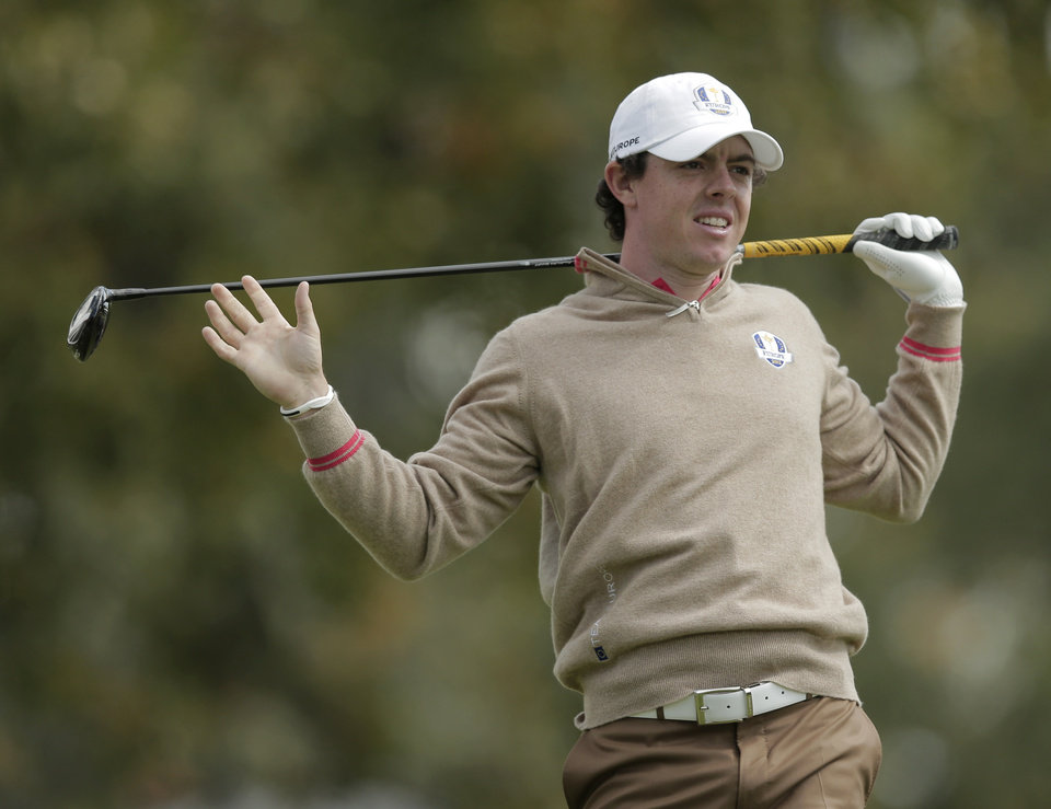 Photo -   Europe's Rory McIlroy watches his drive on the 15th hole during a practice round at the Ryder Cup PGA golf tournament Thursday, Sept. 27, 2012, at the Medinah Country Club in Medinah, Ill. (AP Photo/Charlie Riedel)