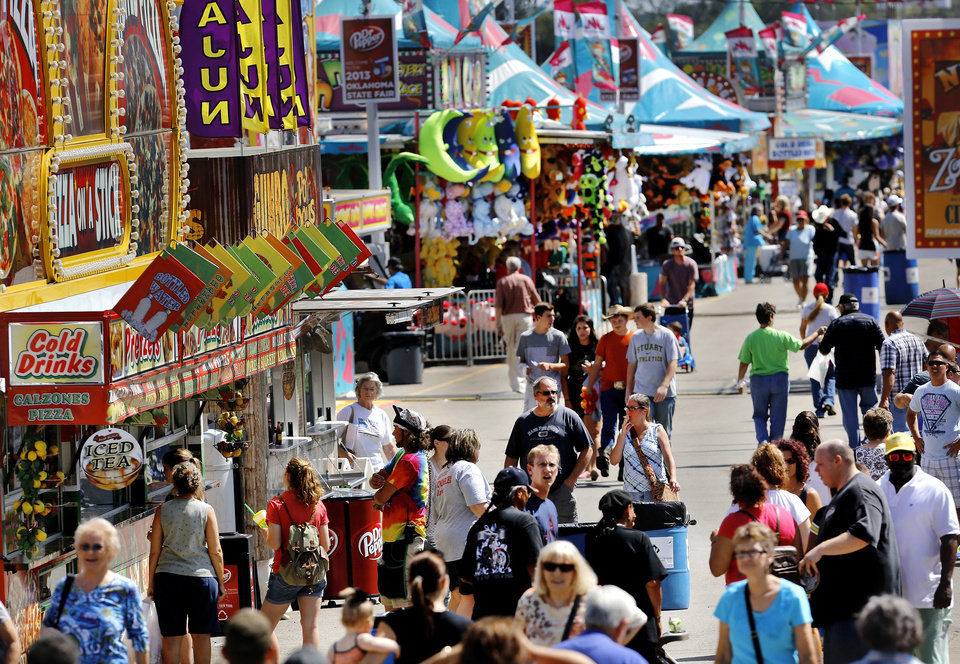 Photo - Crowds along the midway and food row area at the Oklahoma State Fair on Wednesday,  Sep. 18, 2013. Photo  by Jim Beckel, The Oklahoman.