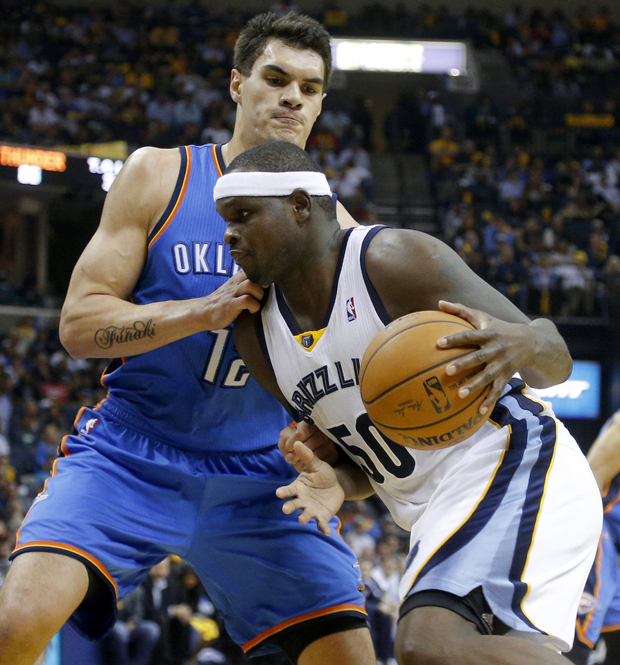 Oklahoma City's Steven Adams (12) defends Memphis' Zach Randolph (50) during Game 6 in the first round of the NBA playoffs between the Oklahoma City Thunder and the Memphis Grizzlies at FedExForum in Memphis, Tenn., Thursday, May 1, 2014. Oklahoma City won 104-84. Photo by Bryan Terry, The Oklahoman