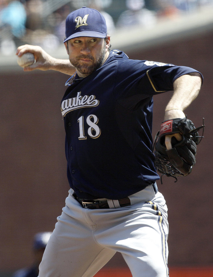 Photo -   Milwaukee Brewers pitcher Shaun Marcum (18) delivers against the San Francisco Giants during the first inning of a baseball game in San Francisco, Sunday, May 6, 2012. (AP Photo/Jeff Chiu)