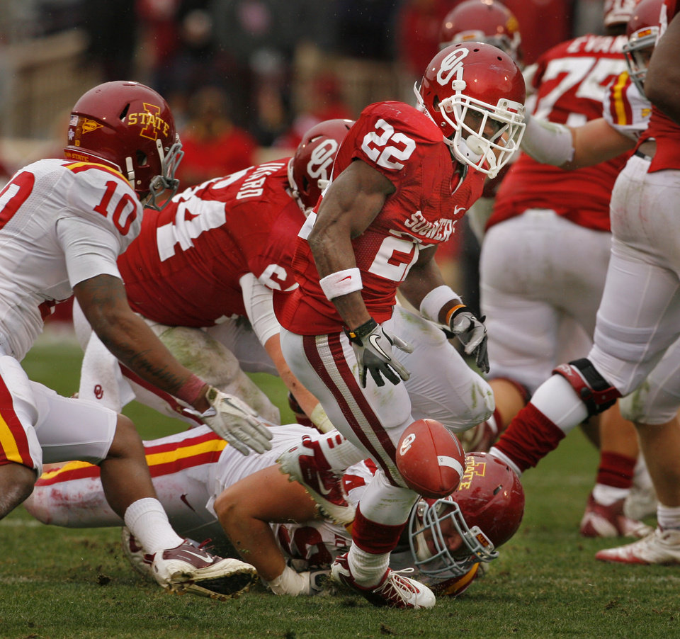 Photo - Iowa State's Jake McDonough (94) causes a fumble by Oklahoma's Roy Finch (22) during the second half of a college football game in which  the University of Oklahoma Sooners (OU) defeated the Iowa State University Cyclones (ISU) 26-6 at Gaylord Family-Oklahoma Memorial Stadium in Norman, Okla., Saturday, Nov. 26, 2011. Photo by Steve Sinsey, The Oklahoman