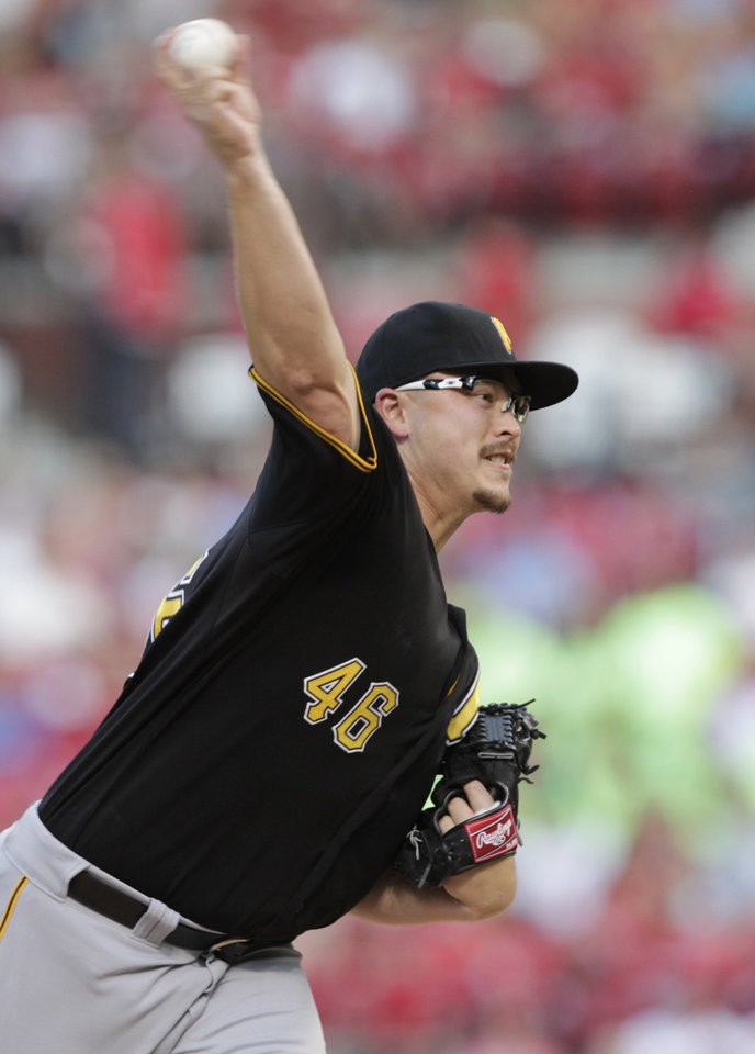 Photo - Pittsburgh Pirates starting pitcher Jared Hughes (48) delivers a pitch in the first inning of a baseball game against the St. Louis Cardinals, Tuesday, July 8, 2014, in St. Louis. (AP Photo/Tom Gannam)