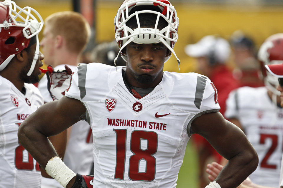 Photo -   A frustrated Washington State's Kristoff Williams exhales as he paces the sidelines during the first half in an NCAA college football game against Arizona State Saturday, Nov. 17, 2012, in Tempe, Ariz. Arizona State defeated the Washington State 46-7.(AP Photo/Ross D. Franklin)