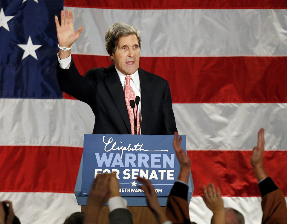 Photo -   FILE - This Nov. 6, 2012 file photo shows Senate Foreign Relations Committee Chairman, Sen. John Kerry waveing after speaking during an election night rally for Sen.-elect Elizabeth Warren, D-Mass. Big changes are coming to the Obama administration _ just not right away. The White House is making the high-stakes fiscal cliff its top priority before President Barack Obama decides major Cabinet changes at Treasury, the State Department and the Pentagon (AP Photo/Michael Dwyer, File)