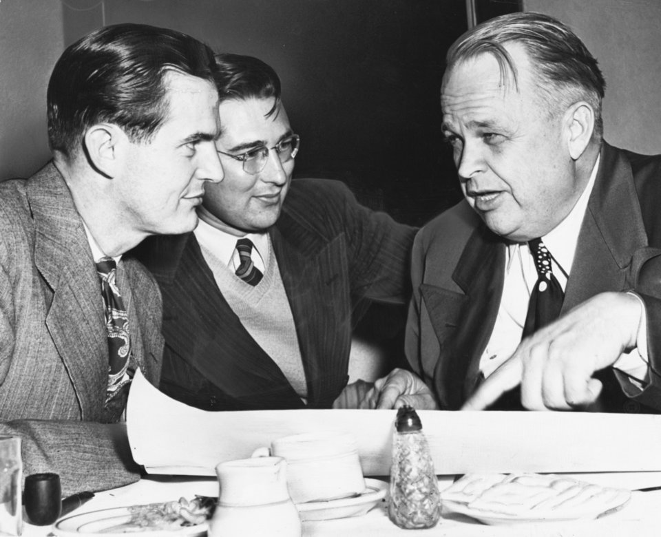 ROBERT S. KERR / OKLAHOMA GOVERNOR / ADA, OKLAHOMA:  River Group Formed - Two of the top officers of the newly organized South Canadian Development association, formed Tuesday night at Ada, are shown with U.S. Sen.-elect Robert S. Kerr, who was one of the original backers of the idea.  They are Bill McCalib, McAlister, left, secretary-treasurer, Kerr and Keith Marshall, Ada, president.  They are looking at a state planning resources board map covering the river basin.  Staff photo by Bill Johnson.  Photo dated 12/01/1948.  Published on 12/02/1948 in The Daily Oklahoman (E).