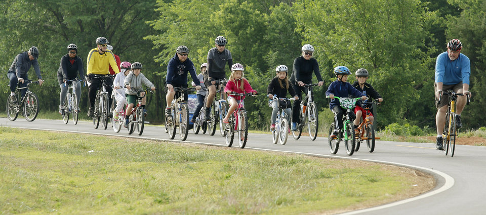 Photo -  The first Edmond Family Bike Ride to encourage families and children to ride their bicycles for fitness and fun was at J.L. Mitch Park. Photo by Doug Hoke, The Oklahoman   DOUG HOKE -