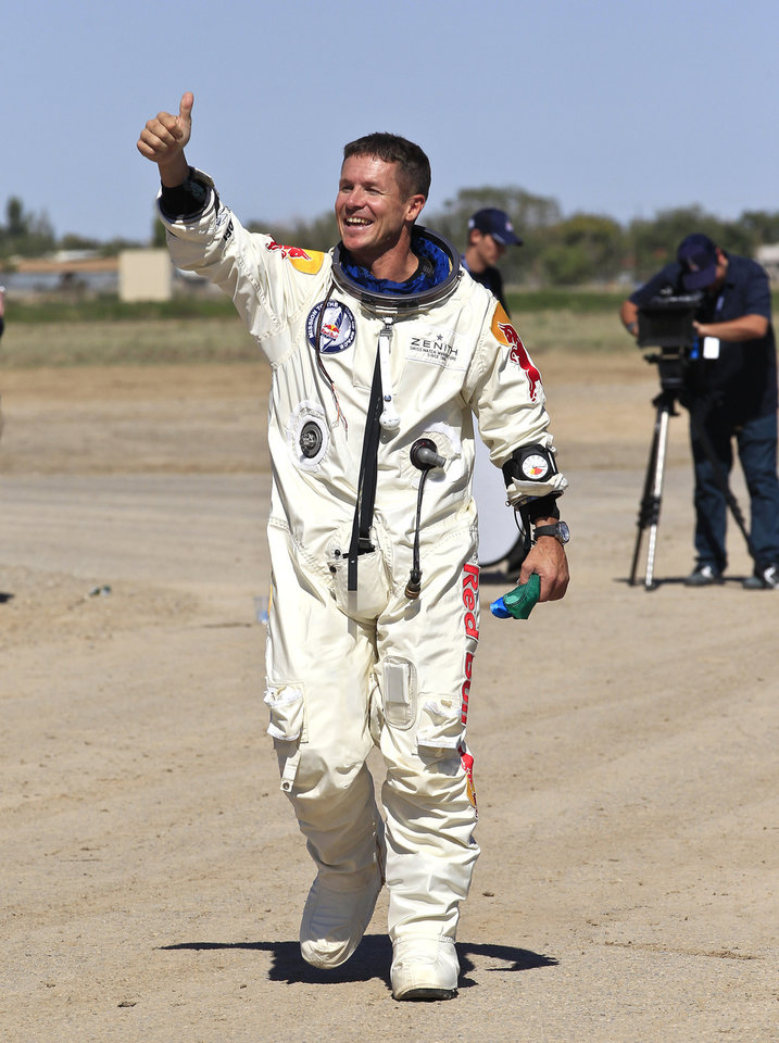 Felix Baumgartner, of Austria, gives a thumbs up to Mission Control staff, family, and friends after successfully jumping from a space capsule lifted by a helium balloon at a height of just over 128,000 feet above the Earth's surface, Sunday, Oct. 14, 2012, in Roswell, N.M. (AP Photo/Ross D. Franklin) ORG XMIT: NMRF128