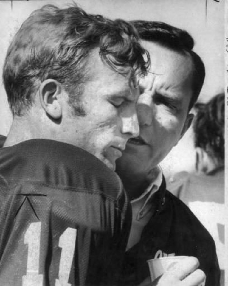 Photo - Jack Mildren gets advice from Chuck Fairbanks in this Oct. 1971 photo.