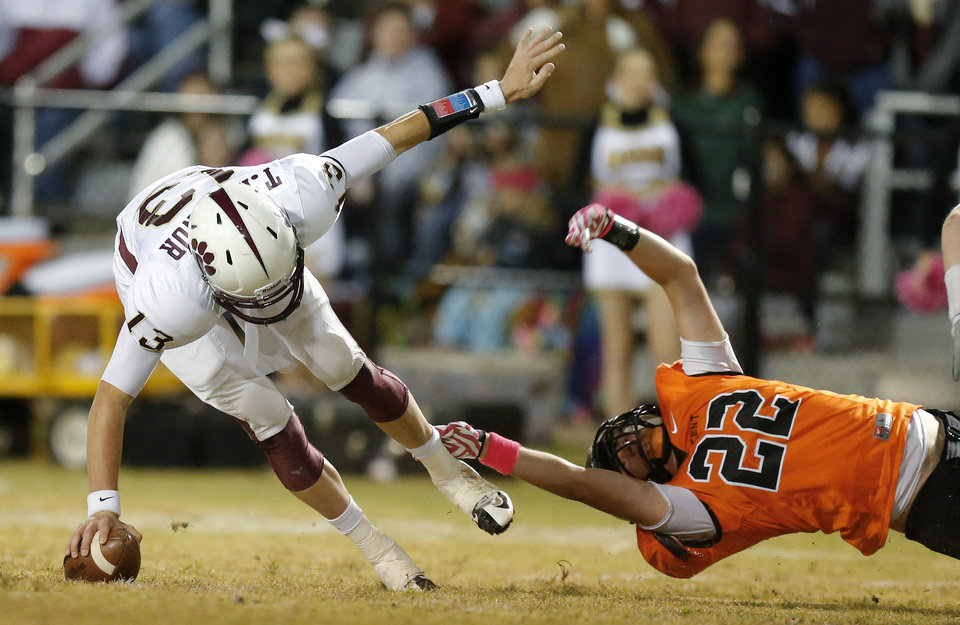 Photo - Crescent's Ty Heiden tries to bring down Ty Reasnor during a high school football game between Cashion and Crescent in Crescent, Okla., Thursday, Oct. 18, 2012. Photo by Bryan Terry, The Oklahoman