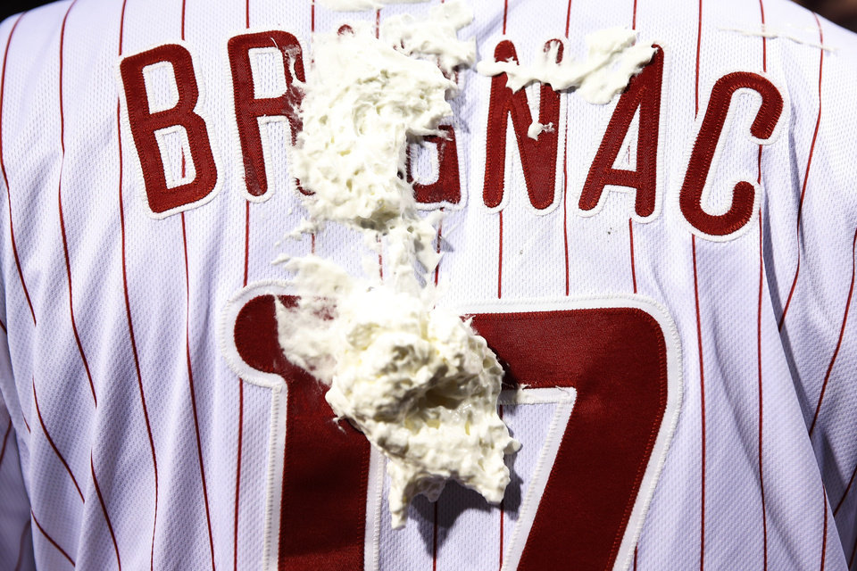 Photo - Shaving cream hangs on the back of Philadelphia Phillies' Reid Brignac after he was hit with it by teammate A.J. Burnett in celebration of Brignac hitting a game-winning three-run home run during the ninth inning of a baseball game against the San Diego Padres, Wednesday, June 11, 2014, in Philadelphia. (AP Photo/Matt Slocum)