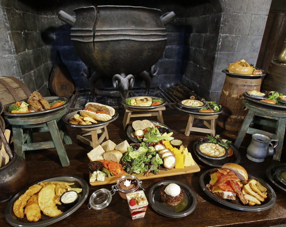 Photo - A display of the various items on the menu that are available are displayed at the Leaky Cauldron restaurant during a preview of Diagon Alley at the Wizarding World of Harry Potter at Universal Orlando, Thursday, June 19, 2014, in Orlando, Fla. (AP Photo/John Raoux)
