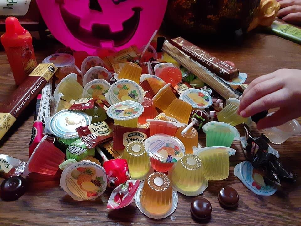 Photo - Kyla McDonnell, 4, daughter of Features Writer Brandy McDonnell, selects a Malaysian jelly from an assortment of international candies Instead of trick-or-treating during the pandemic, plan a family taste test with new delicacies. [Brandy McDonnell/The Oklahoman]