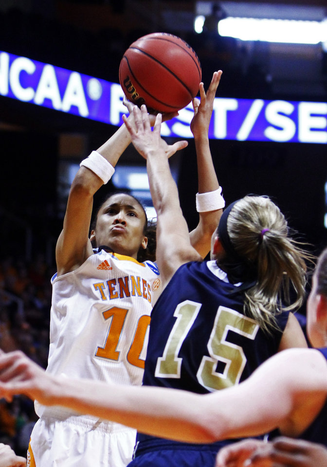 Photo - Tennessee guard Meighan Simmons (10) shoots over Oral Roberts guard Kevi Luper (15) in the second half of a first-round game in the women's NCAA college basketball tournament, Saturday, March 23, 2013, in Knoxville, Tenn. Tennessee won 83-62. (AP Photo/Wade Payne)