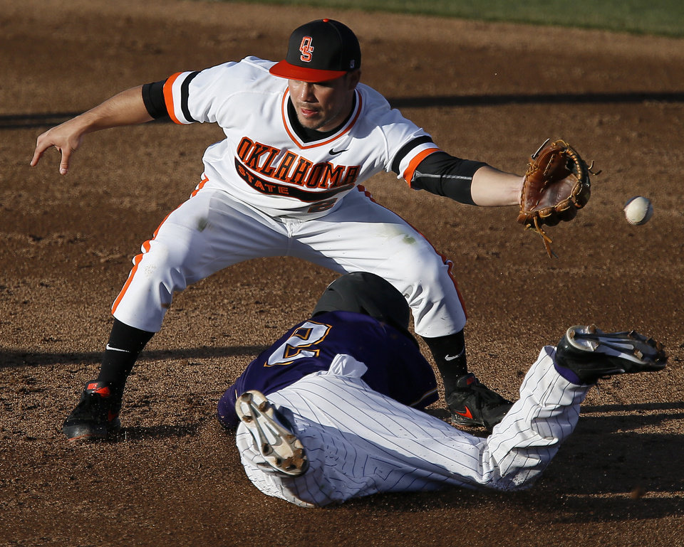 Oklahoma State's Tim Arakawa can't reach the ball as Alcorn State's Moses Charles slides to second base in the fourth inning of their baseball game in Stillwater, Tuesday, Feb. 18, 2014. Photo by Bryan Terry, The Oklahoman