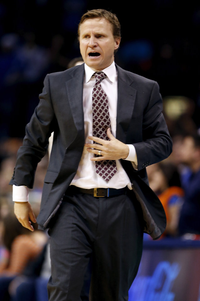 Head coach Scott Brooks talks to his team in the second half of an NBA basketball game where the Oklahoma City Thunder were defeated 95-93 by the Brooklyn Nets at the Chesapeake Energy Arena in Oklahoma City, on Thursday, Jan. 2, 2014. Photo by Steve Sisney The Oklahoman