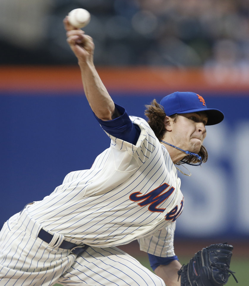 Photo - New York Mets starting pitcher Jacob deGrom, making his major league debut, delivers in the first inning of a baseball game against the New York Yankees in New York, Thursday, May 15, 2014. (AP Photo/Kathy Willens)