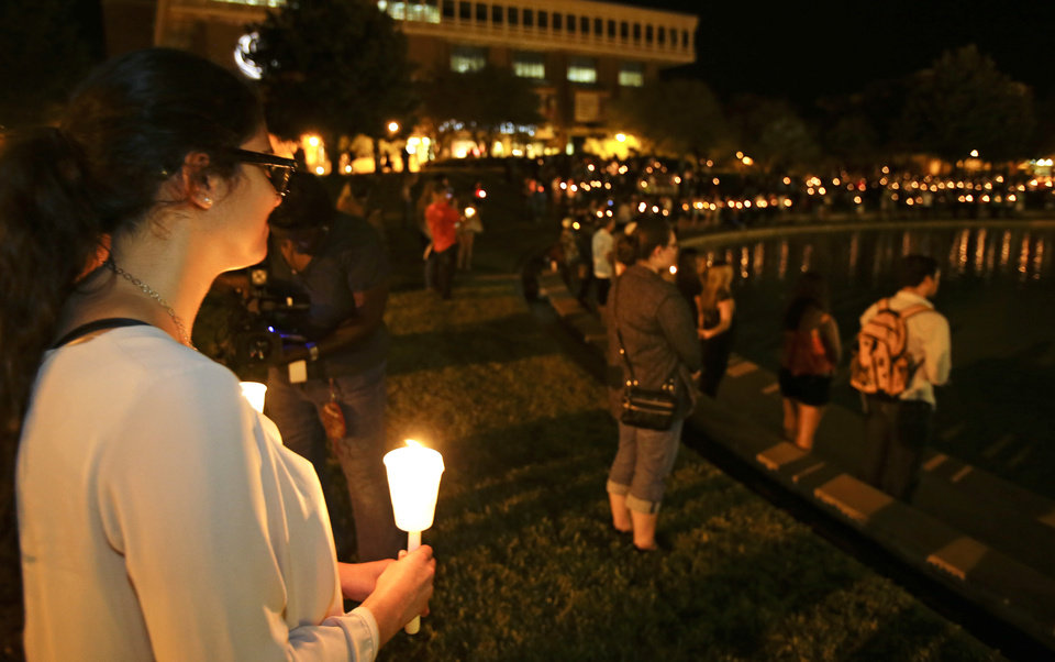 Photo - Students and supporters take part in a candle light vigil at the University of Central Florida, Wednesday, Sept. 3, 2014, in Orlando, Fla., to honor Steven Sotloff, the second American journalist to be beheaded by Islamic State militants in two weeks. Sotloff attended University of Central Florida between 2002 and 2004. (AP Photo/John Raoux)