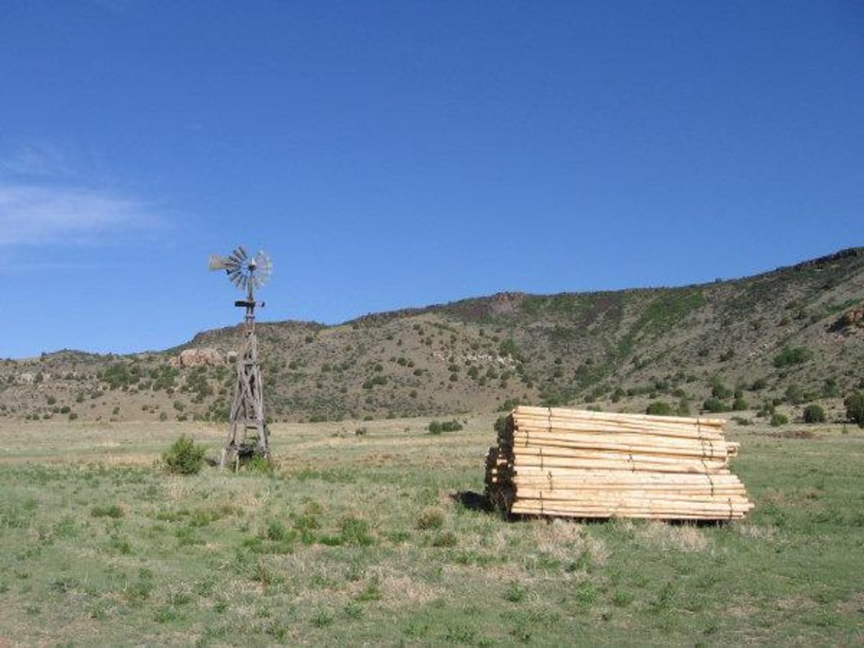 Windmills like this one dot the landscape in Cimarron County, where a scarcity of water makes raising cattle difficult. <strong>Photo provided - Photo provided</strong>