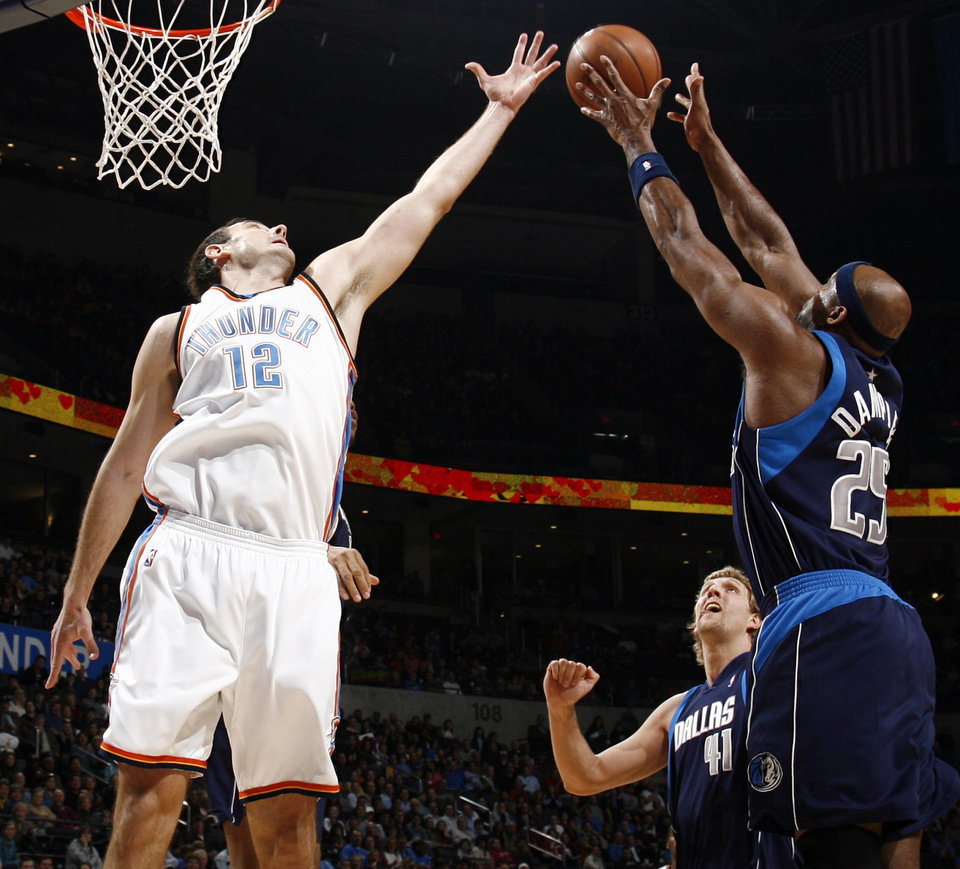 Oklahoma City\'s Nenad Krstic (12) and Erick Dampier (25) try for a rebound as Dirk Nowitzki (41) looks on in the first half during the NBA basketball game between the Dallas Mavericks and the Oklahoma City Thunder at the Ford Center in Oklahoma City, March 2, 2009. BY NATE BILLINGS, THE OKLAHOMAN