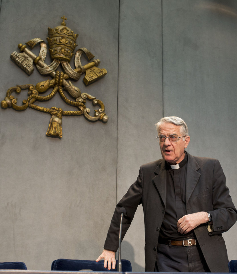 Photo - Vatican spokesman the Rev. Federico Lombardi arrives for a press conference at the Vatican, Monday, July 7, 2014. Pope Francis has held his first meeting with a group of Catholics who were sexually abused by clergy. Lombardi said two Irish, two British and two German victims met separately Monday for about 30 minutes apiece with Francis at the pope's Vatican hotel.  Lombardi said Francis had already greeted the six Sunday evening at dinner. (AP Photo/Alessandra Tarantino)