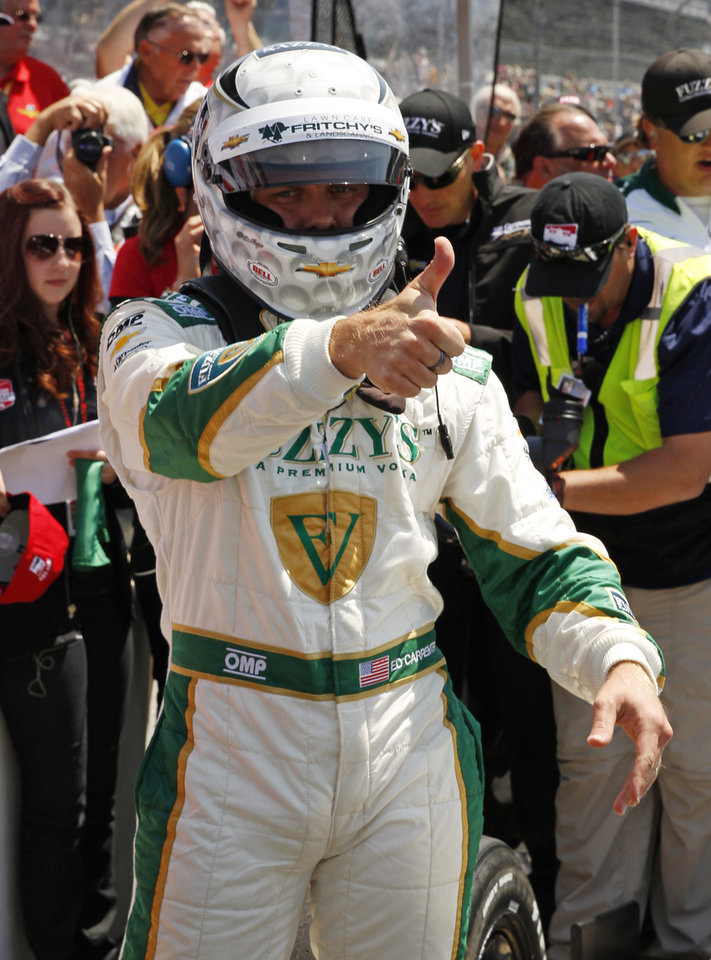 Photo - Ed Carpenter celebrates after winning the pole during qualifications for the Indianapolis 500 IndyCar auto race at the Indianapolis Motor Speedway in Indianapolis, Sunday, May 18, 2014. (AP Photo/Tom Strattman)