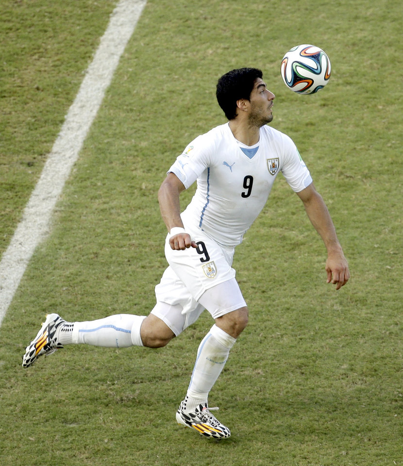 Photo - Uruguay's Luis Suarez controls the ball during the group D World Cup soccer match between Italy and Uruguay at the Arena das Dunas in Natal, Brazil, Tuesday, June 24, 2014. (AP Photo/Hassan Ammar)