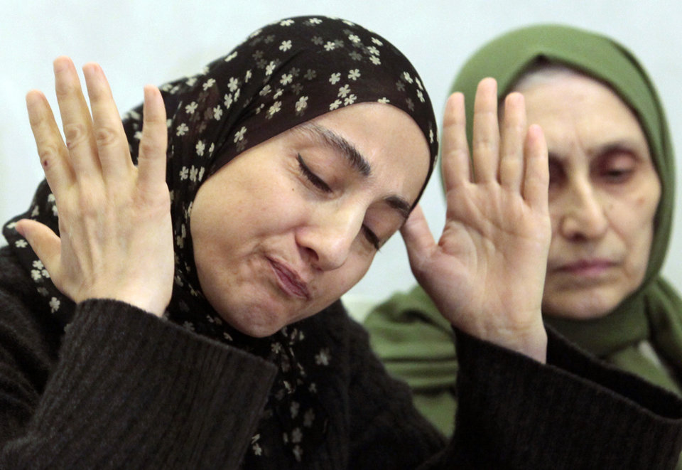 Photo - FILE - This April 25, 2013 file photo shows the mother of the two Boston bombing suspects, Zubeidat Tsarnaeva, left, speaking at a news conference in Makhachkala, the southern Russian province of Dagestan. Two government officials tell The Associated Press that U.S. intelligence agencies added the Boston bombing suspects' mother to a federal terrorism database about 18 months before the attack. At right is her sister-in-law Maryam. (AP Photo/Musa Sadulayev, File)