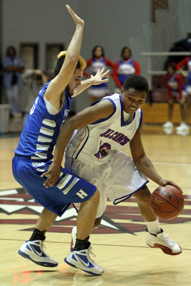 Millwood's Chris Crook drives past Haskell's Dalton Cefalone during the Class 3A boys basketball game between Millwood and Haskell at Southern Nazarene University in Bethany Thursday, March 8th, 2012. PHOTO BY HUGH SCOTT, FOR THE OKLAHOMAN
