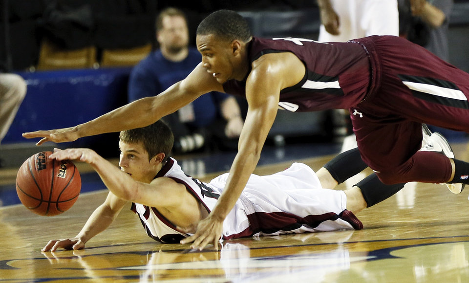 Edmond Memorial's Jordan Woodard (10), top, and Owasso's Avery Culbertson (10) chase a loose ball during a Class 6A boys high school basketball game in the semifinals of the state tournament at the Mabee Center in Tulsa, Okla., Friday, March 8, 2013. Edmond Memorial beat Owasso, 53-50, in double-overtime. Photo by Nate Billings, The Oklahoman