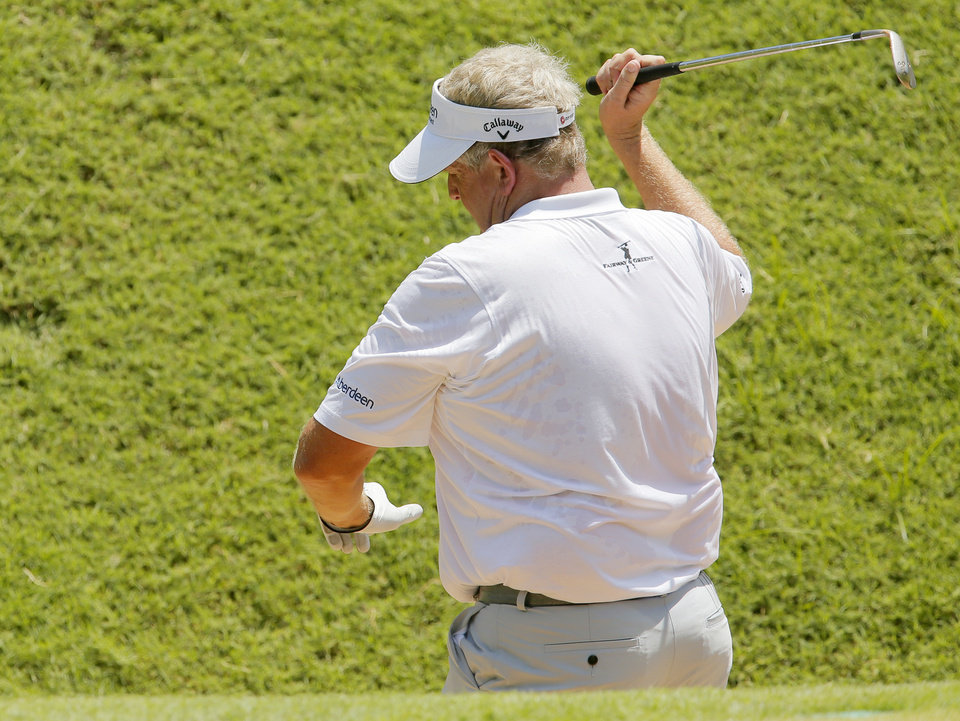 Photo - Colin Montgomerie reacts after a bunker shot on No. 4 during the final round of the U.S. Senior Open golf tournament at Oak Tree National in Edmond, Okla., Sunday, July 13, 2014. Photo by Nate Billings, The Oklahoman