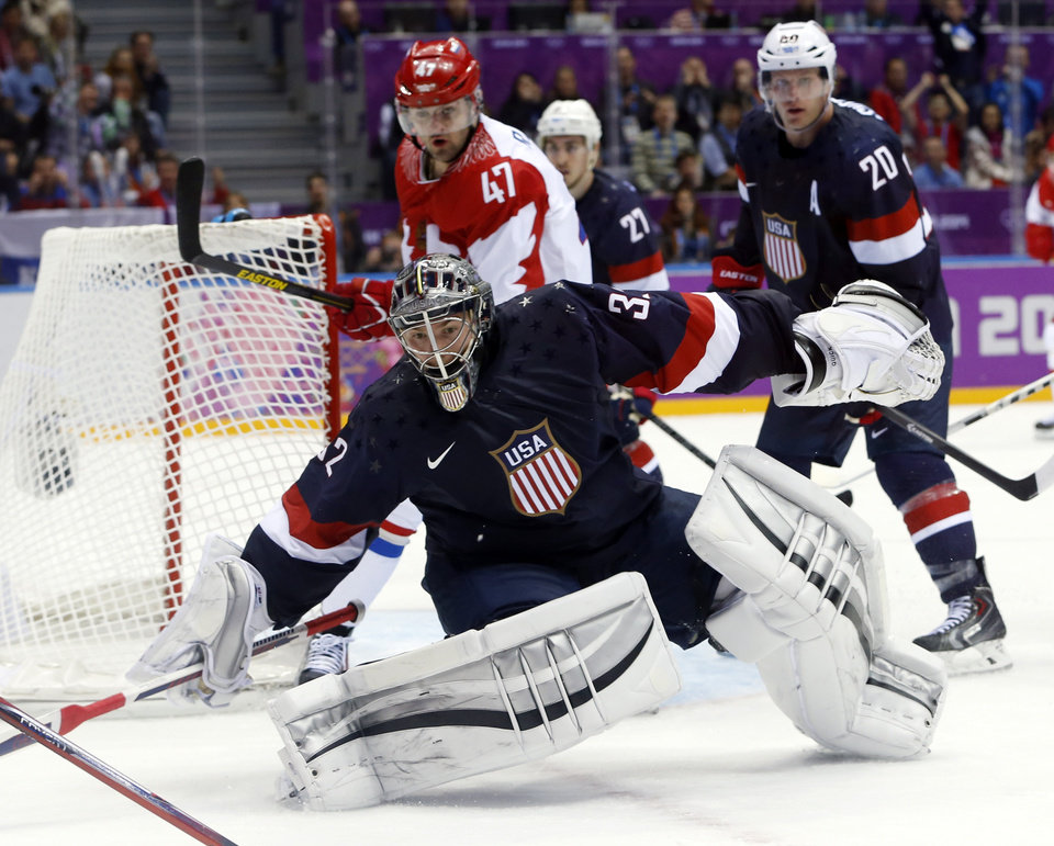 Photo - USA goaltender Jonathan Quick comes out of the crease to defend the goal in the third period of a men's ice hockey game at the 2014 Winter Olympics, Saturday, Feb. 15, 2014, in Sochi, Russia. (AP Photo/Mark Humphrey)