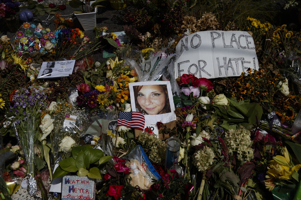 Photo - A photo of Heather Heyer, who was killed during a white nationalist rally, sits on the ground at a memorial the day her life was celebrated at the Paramount Theater, Wednesday, Aug. 16, 2017, in Charlottesville, Va. (AP Photo/Evan Vucci)