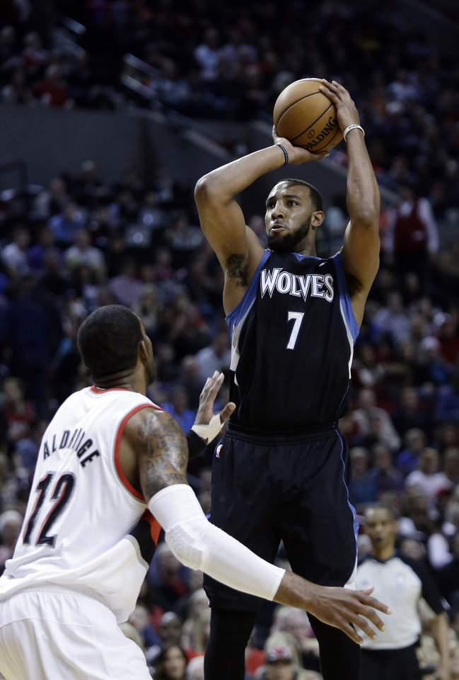 Minnesota Timberwolves forward Derrick Williams, right, shoots over PortlandTrail Blazers forward LaMarcus Aldridge during the first quarter of an NBA basketball game in Portland, Ore., Saturday, March 2, 2013. (AP Photo/Don Ryan)
