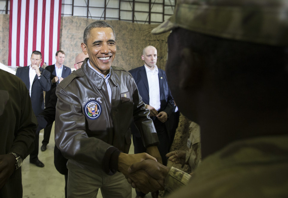 Photo - President Barack Obama shakes hands during a troop rally at Bagram Air Field, north of Kabul, Afghanistan, during an unannounced visit on Sunday, May 25, 2014. (AP Photo/ Evan Vucci)