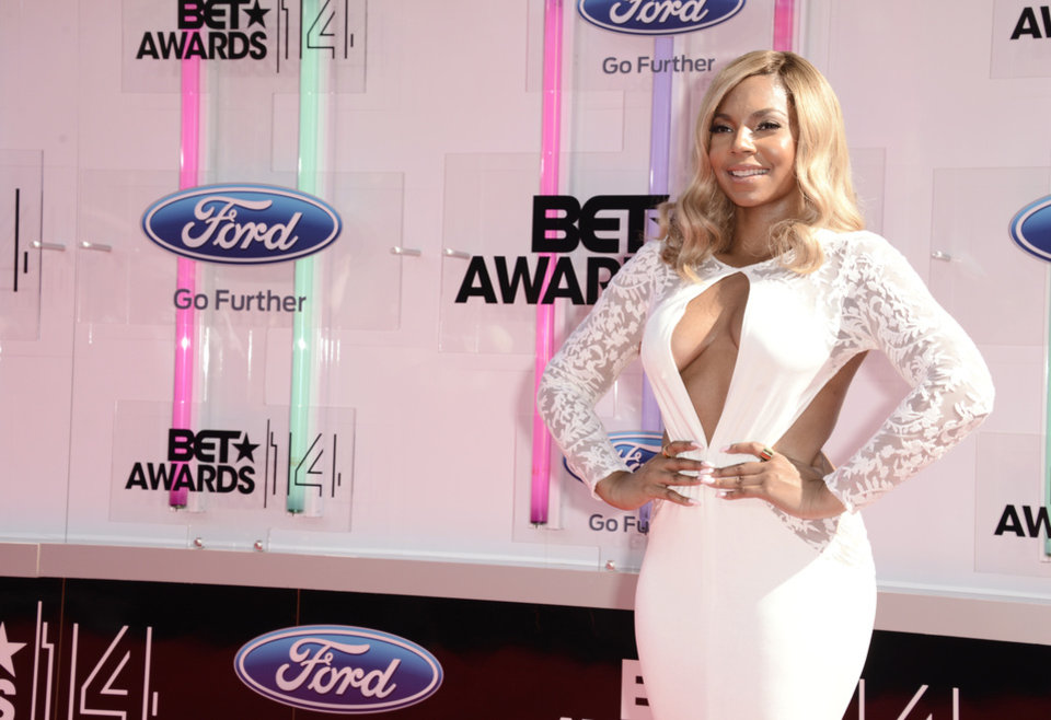 Photo - Ashanti arrives at the BET Awards at the Nokia Theatre on Sunday, June 29, 2014, in Los Angeles. (Photo by Dan Steinberg/Invision/AP)